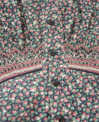"""Old Friends"" romper suit. Close up smocking"