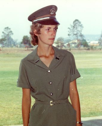 C1978: A female recruit dressed in the summer uniform for an event.