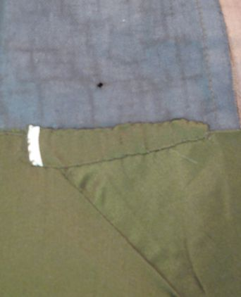 Additional material has been used to repair the skirt hem