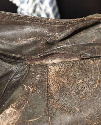 Leather coat under collar damage