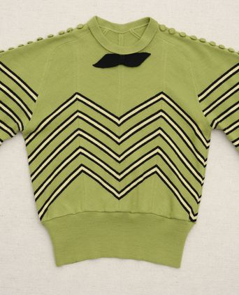 Front view of lime green jumper, with black and pale yellow chevron stripes