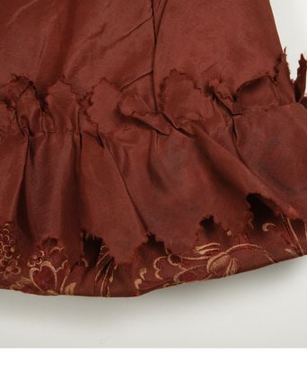 Pinked ruffle on inside of hem.