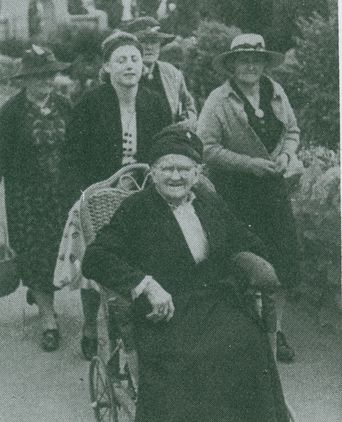Granny Jane Crain being pushed in a home-made wheelchair by her granddaughter Doris Maxworthy.