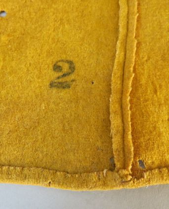 '2' stamp - possibly a size or issue number & internal seam finishing. Photographed 03/09/2013, Deb Wise