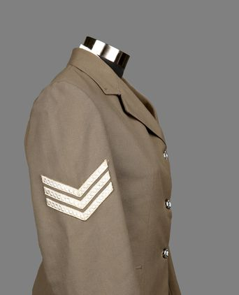 Three chevrons indicating rank of Sergeant Second Class on right sleeve.