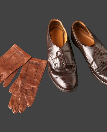 Gloves and shoes that form part of the drab olive winter uniform.