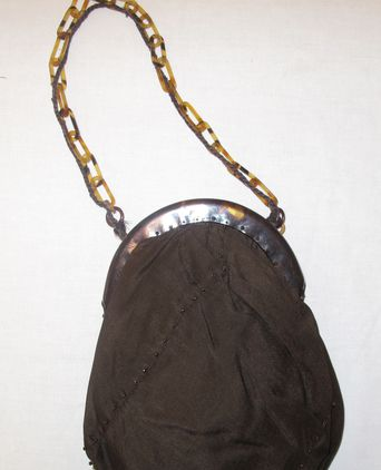 Brown silk, beaded bag worn with the ensemble