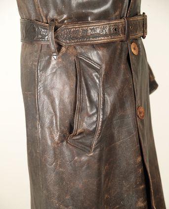Leather coat welt pocket detail