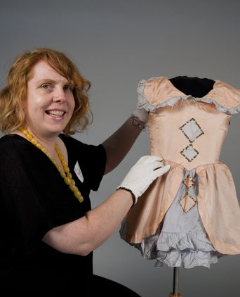 Dance costume worn by Pauline Harvey as a child and Michelle Maddison curator Museum of the Riverina
