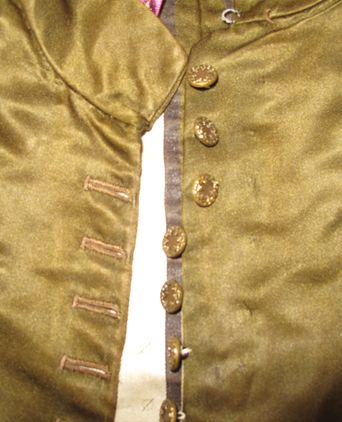 Bodice close up - showing 4 of the 12 decorative buttons that have been unstitched and restitched to the edge of the bodice to allow for larger size