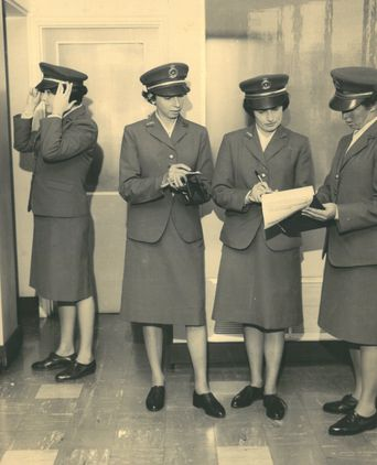 PM1812b. These women are wearing the first style of winter uniform issued to female officers in June 1965.