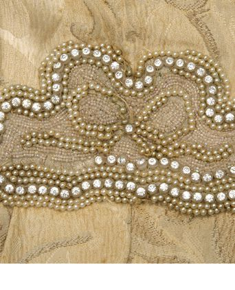 Pearl beading is missing from central decoration.