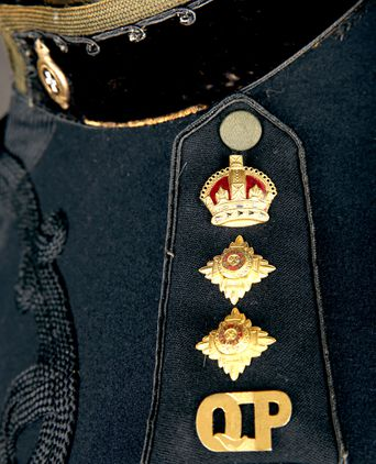 The rank insignia of a Commissioner of Police