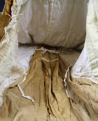 Inside of back skirt/bustle. Two cotton ties help hold the fullness in place