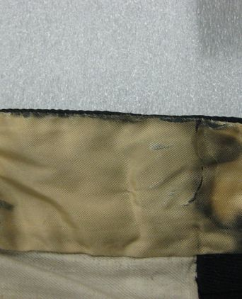 Water damage to the trouser waistline lining [taken 9-11-09]